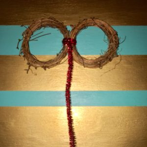 Take two of your mini vine wreaths and secure them together with pipe cleaners. DIY Paw Wreath For The Pet Lover