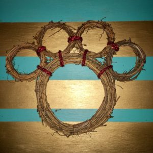 Now take your connected mini wreaths and attach them to the main wreath using pipe cleaners. DIY Paw Wreath For The Pet Lover