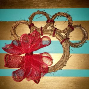 Attach the mesh arrangement to your wreath with the pipe cleaner attached. DIY Paw Wreath For The Pet Lover